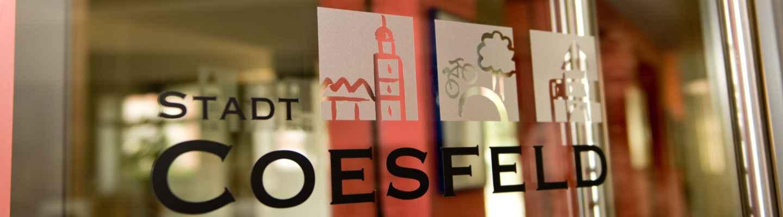 Büroscheibe mit aufgebrachtem Logo der Stadt Coesfeld